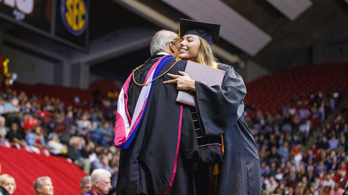 UA graduate hugging University President at Commencement